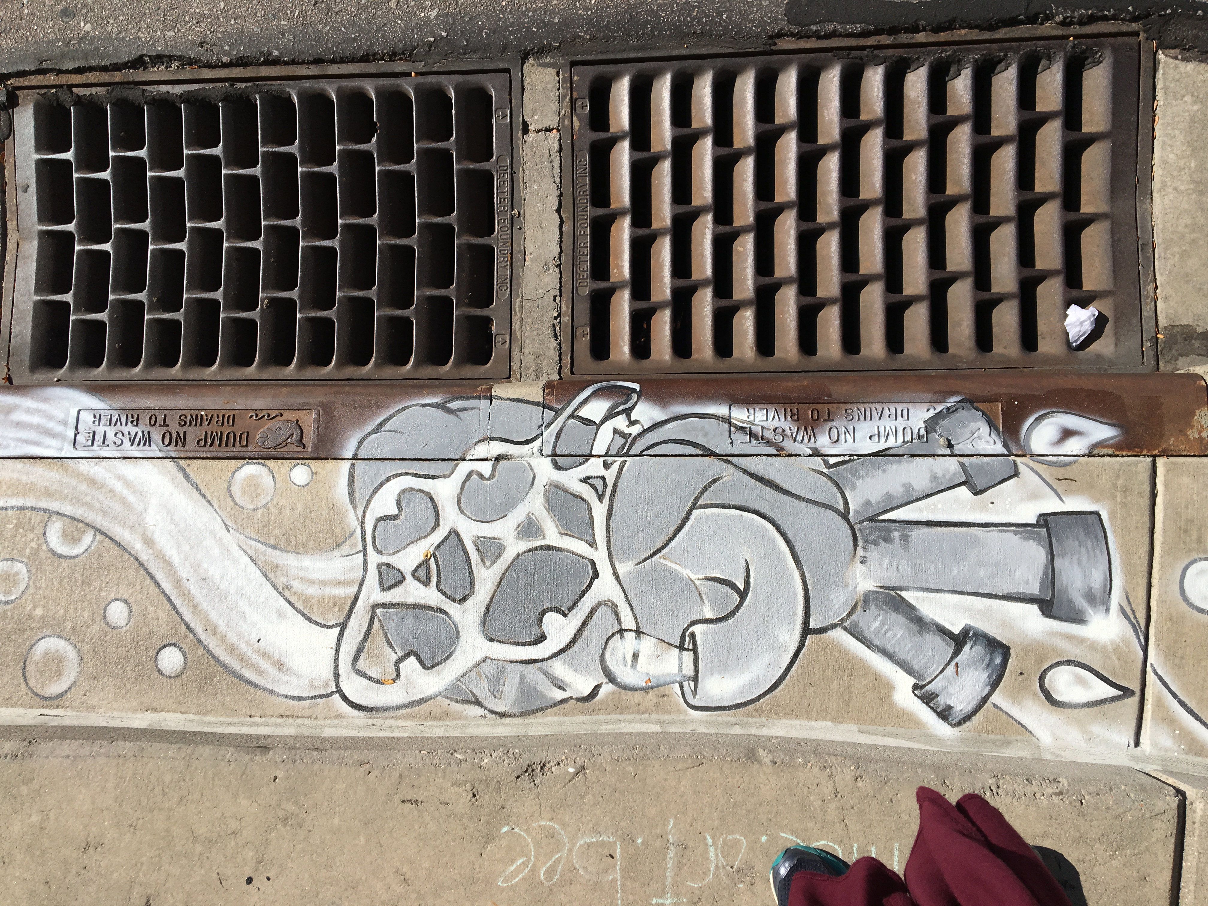 Painting of pollution going down storm drain and into water
