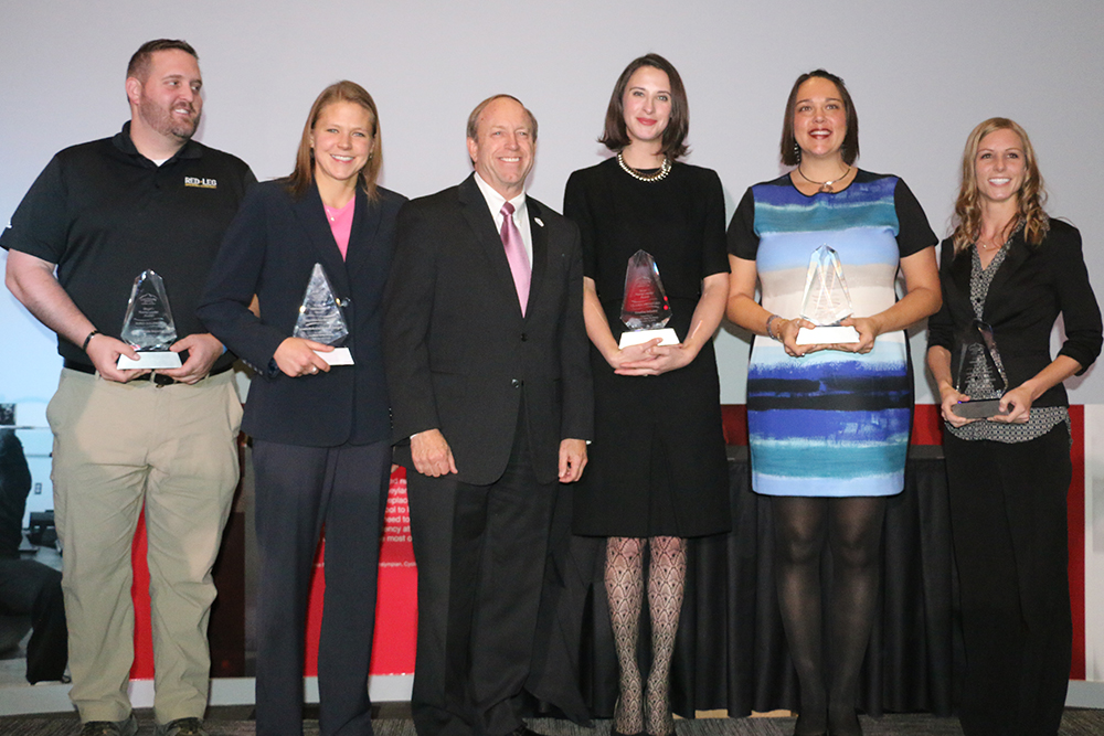 group photo of mayor and young leader award winners holding their award