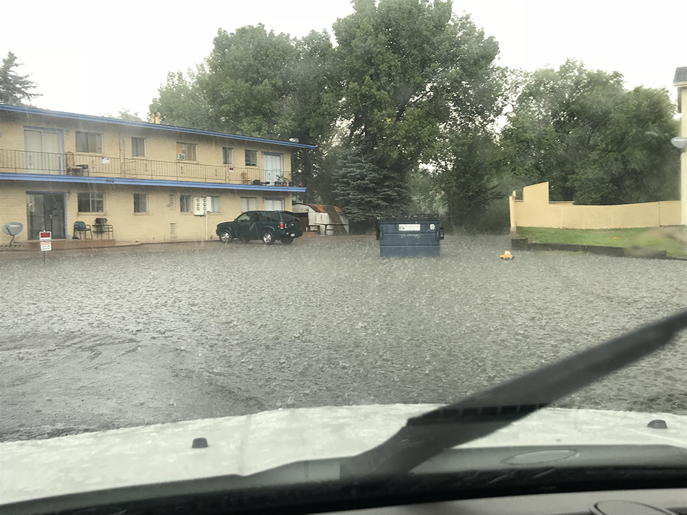 Flood water covers cul-de-sac and goes up to apartment building