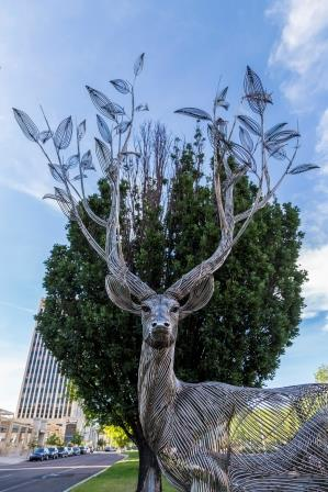 metal-wire deer with tree branches for antlers