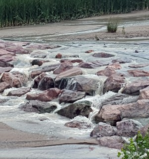 large rocks with water running down them in Cottonwood Creek