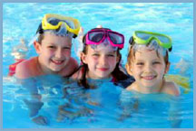 closeup photo of three children in a pool