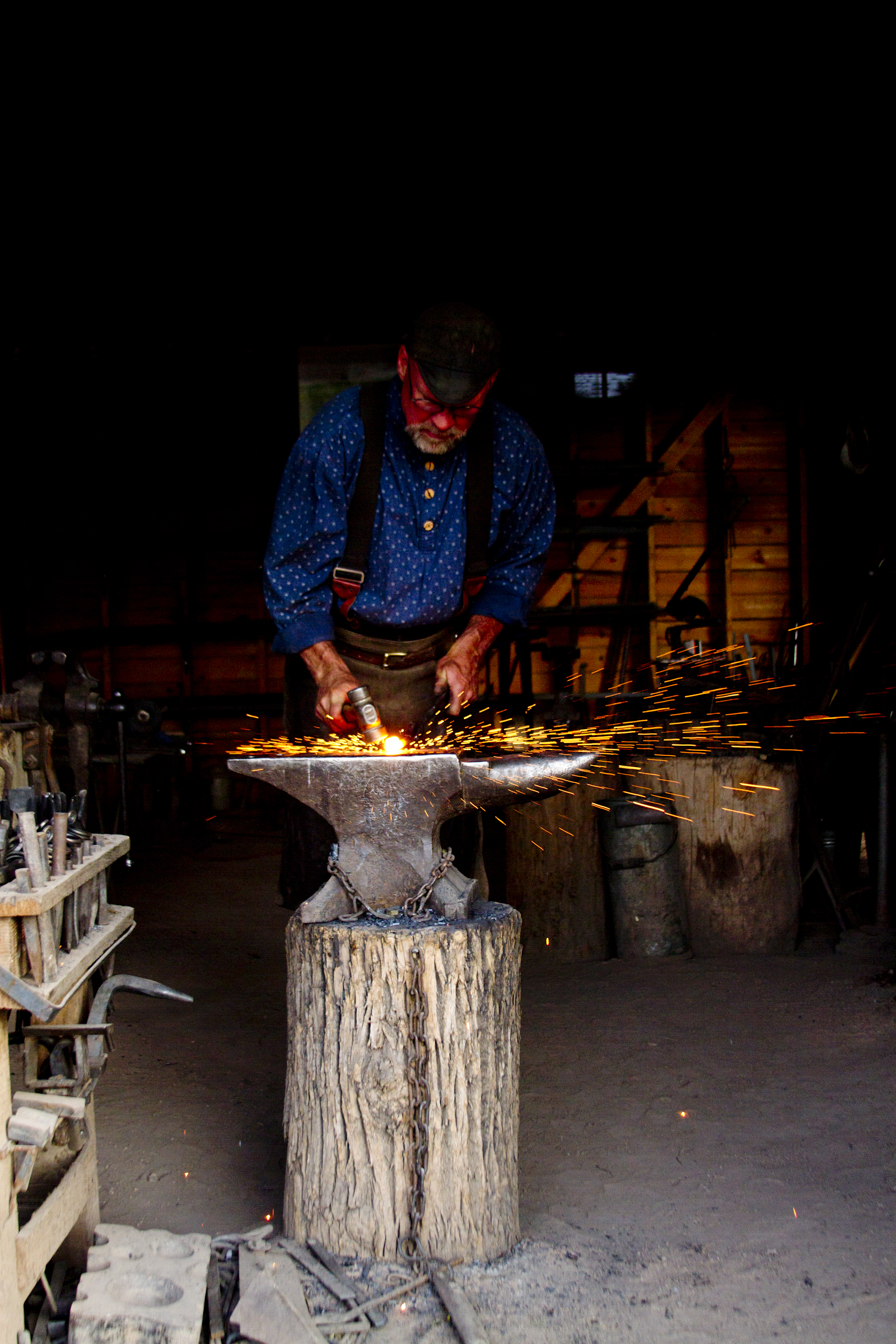 Blacksmith working iron in his shop