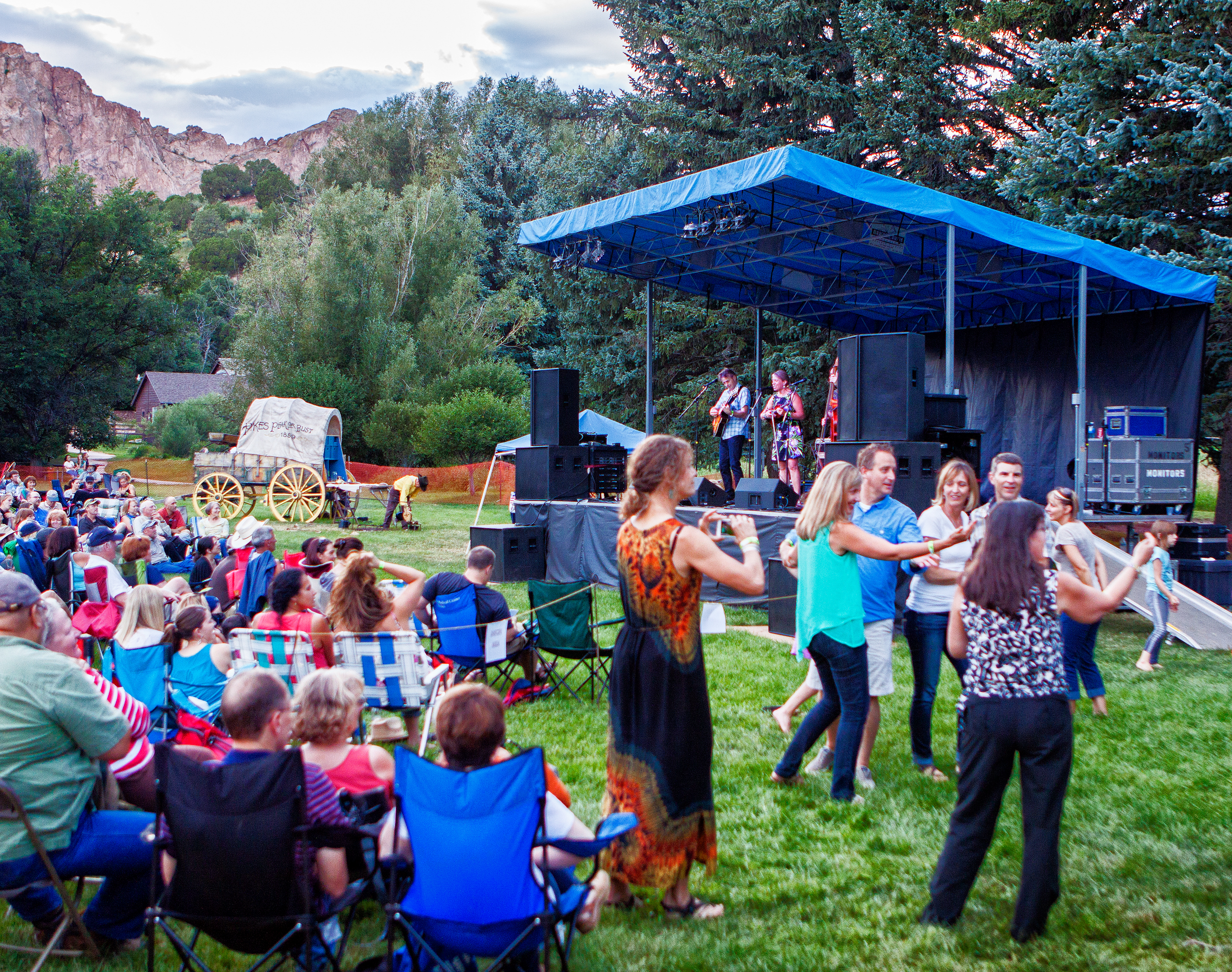 People celebrating at a festival at Rock Ledge Ranch