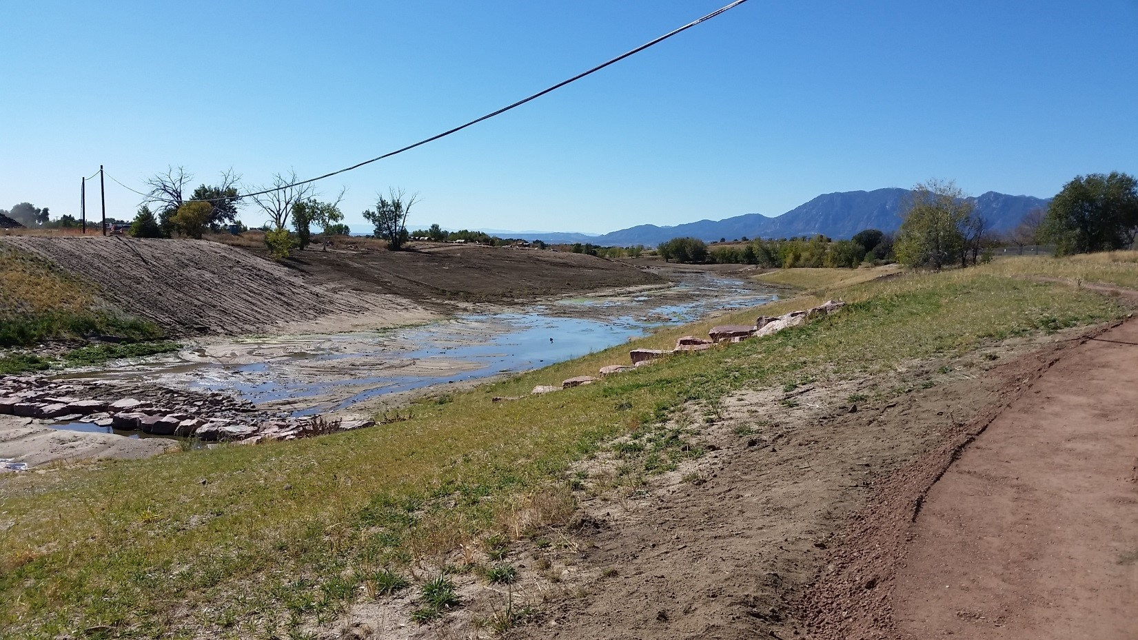 After photo - showing grassy creek bank and waterway