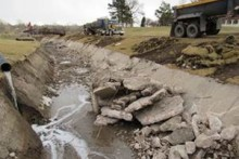 Drainage ditch with a lot of broken up concrete