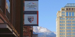 Olympic City USA banner downtown with Pikes Peak in the background